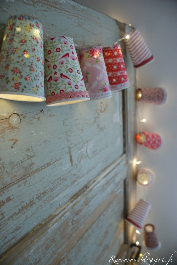 Lamps made with paper cups, fabric, lace, etc. on string lights. Very cute!