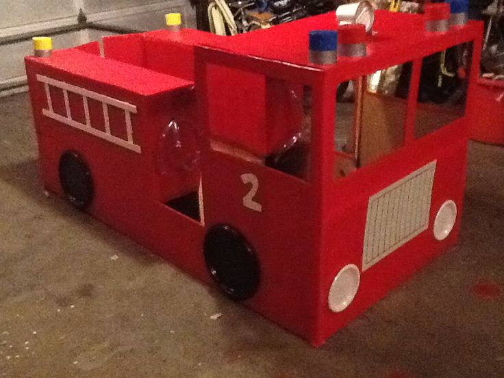 Owen's Firetruck to celebrate his 2nd birthday party.  A refrigerator box, some supplies from leftover halloween costumes and other projects, and some items from the dollar store and the hardware store.  And some evenings of working on a project with the hubs :).