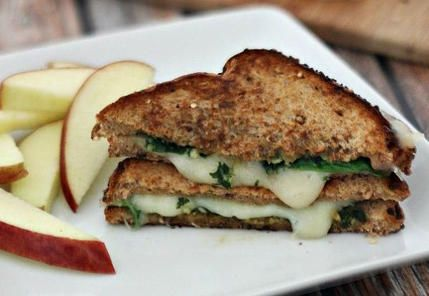 Spreading pesto on your grilled cheese adds flavor without too many extra calories.
