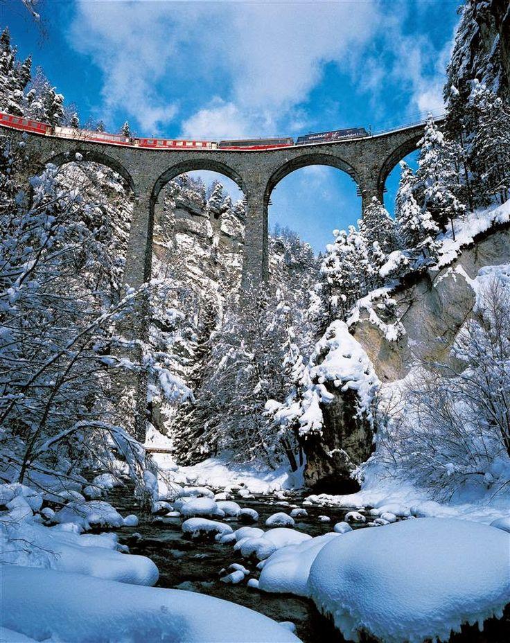 Train crossing the mountains onLandwasser Viaduct, Graubunden, Switzerland.