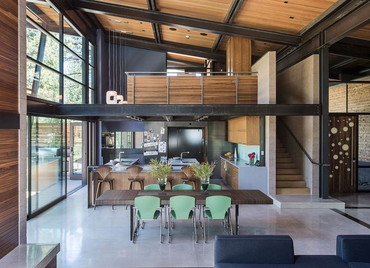 An open-plan, double-height dining area.