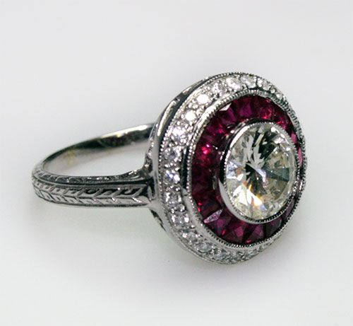 """Diamond and Ruby Engagement Ring  1930s    diamond and ruby engagement ring set in 18 carat gold. The diamond is approximately 2 carats."""