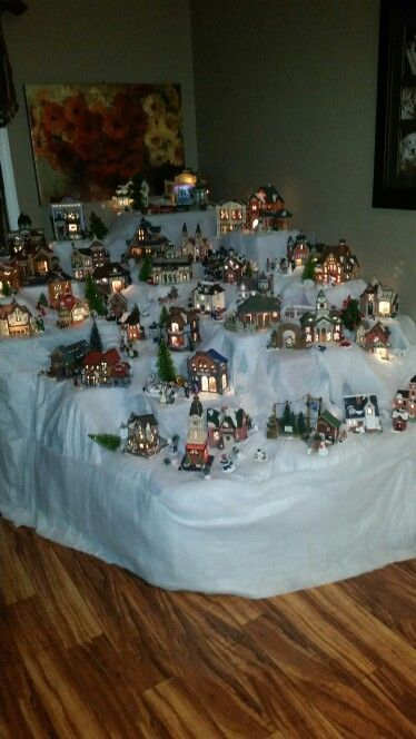 Christmas village set up.  I use the boxes and Styrofoam from the houses to make the village multi-level.