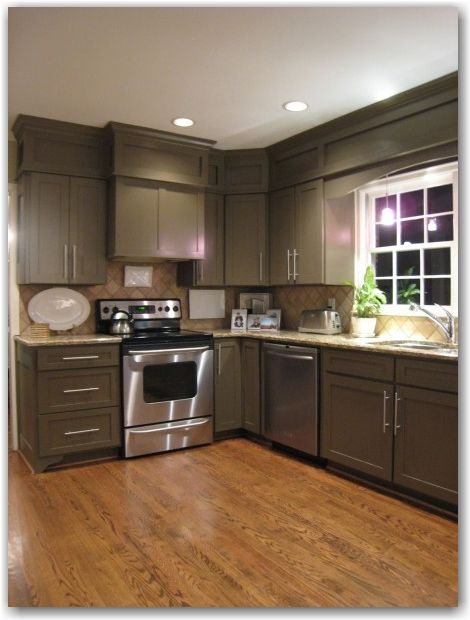 If white doesn't work... Cabinets are painted Sherwin Williams Brainstorm Bronze.  Classy look.