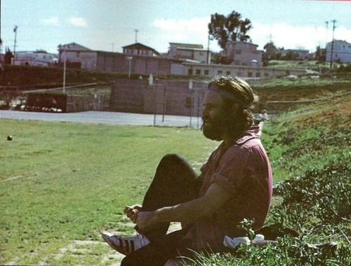 Jim Morrison. Taken right before Jim left for Paris, 1971. He was playing a game of football with friends here.