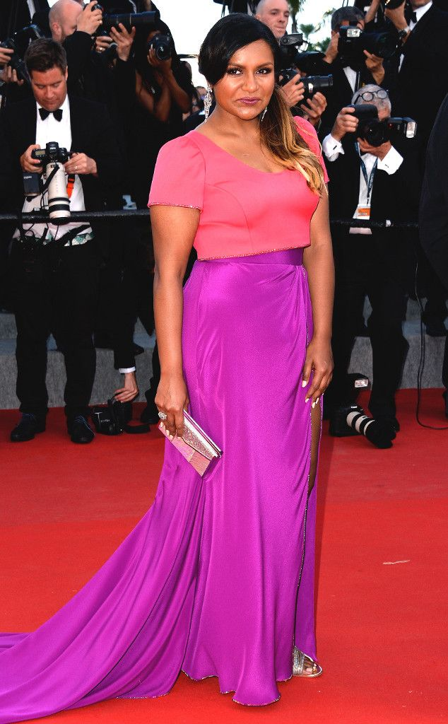 2015 Cannes: Mindy Kaling is wearing a color block pink/purple Salvador Perez short sleeve gown. I like Mindy's style and comedy! Gorgeous gown. Mindy is wonderful in it! Work it, Mindy!