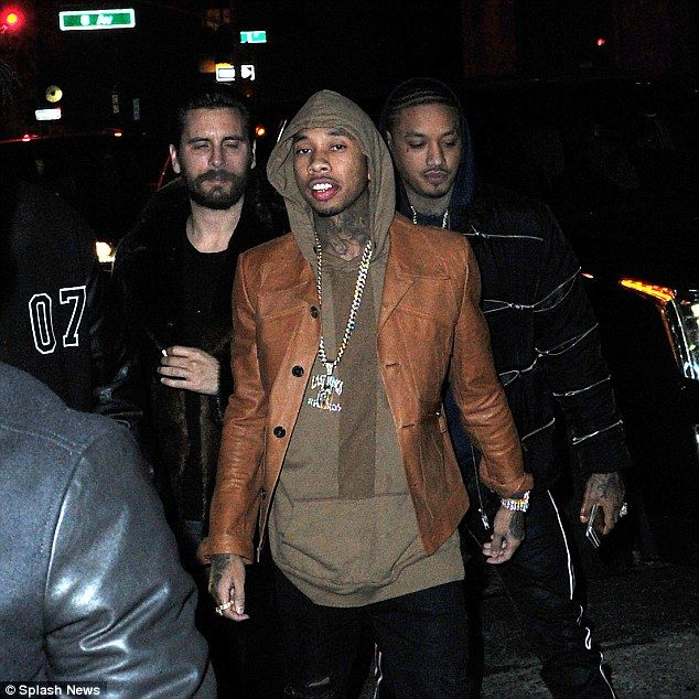 King of bling: Tyga sported his customary bling, with a thick gold chain hanging around his neck, a a flashy watch on his wrist and a statement ring on his right hand