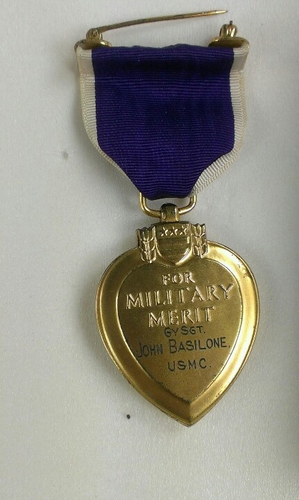 This Purple Heart was posthumously issued to John Basilone (November 4, 1916 – February 19, 1945). Basilone was a United States Marine Gunnery Sergeant who received the Medal of Honor for his actions at the Battle of Guadalcanal during World War II. He was the only enlisted Marine in World War II to receive the Medal of Honor and the Navy Cross.  He served three years in the United States Army with duty in the Philippines before joining the Marine Corps in 1940 - hence the nickname Manila…