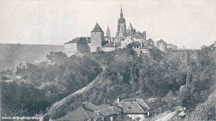 Prague Castle 1885. According to the Guinness Book of Records, Prague Castle is the largest ancient castle in the world, occupying an area of almost 70,000 square metres (750,000 square feet), at about 570 metres (1,870 feet) in length and an average of about 130 metres (430 feet) wide. The castle is among the most visited tourist attractions in Prague attracting over 1.8 million visitors annually.