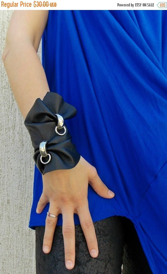 Black genuine leather bracelet with two accessories made of the finest metal. Versatile bracelet. Material: 100% leather The royal blue top in the pictures: https://www.etsy.com/listing/231569125/royal-blue-top-casual-blue-summer-blouse  Black pants in the last picture: https://www.etsy.com/listing/231577440/black-leggings-black-rock-pants-black