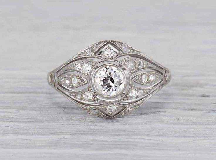 Antique Early Art Deco ring made in platinum and centered with an approximately .45 carat old European cut diamond. Circa 1920.