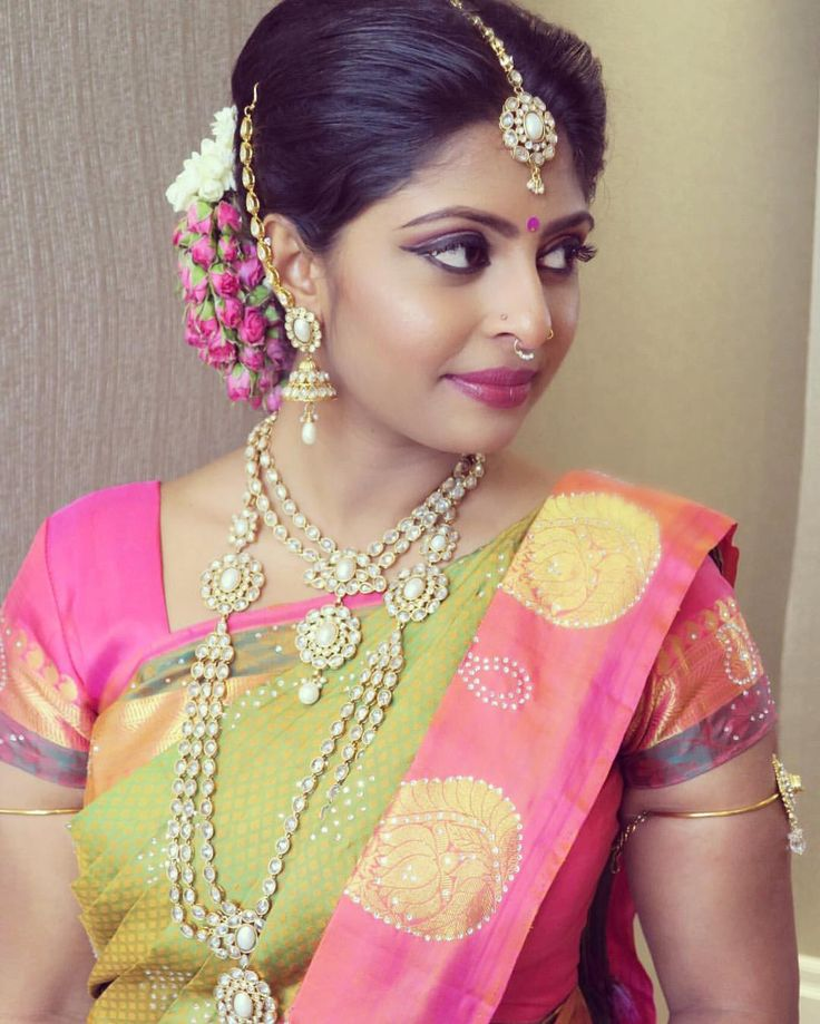 South Indian bride. Gold Indian bridal jewelry.Temple jewelry. Jhumkis. Pink and green silk kanchipuram sari.Braid with fresh jasmine flowers. Tamil bride. Telugu bride. Kannada bride. Hindu bride. Malayalee bride.Kerala bride.South Indian wedding.