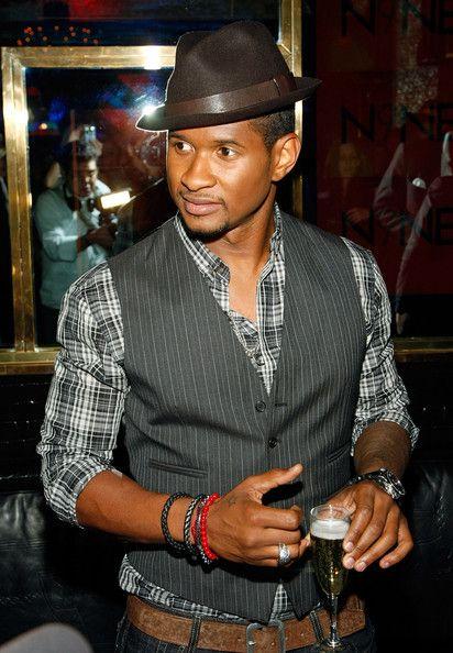 Usher isn't afraid to create a fashionable man....very dap!
