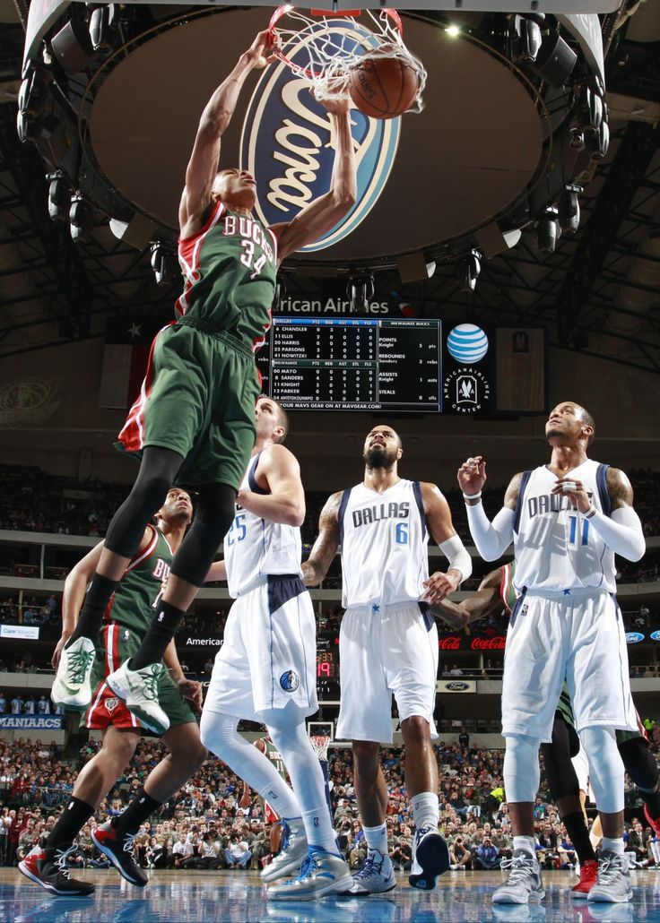 Giannis Antetokounmpo #34 of the Milwaukee Bucks dunks against the Dallas Mavericks on December 7, 2014 at the American Airlines Center in Dallas, Texas. Photo by Danny Bollinger/NBAE via Getty Images