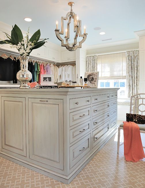 A glamorous closet designed by Gray Walker Interiors includes Niermann Weeks Monaco Chandelier.  niermannweeks.com #NiermannWeeks
