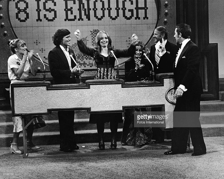 Host Richard Dawson speaks to the cast of the television series, 'Eight Is Enough' as they compete on the game show, 'Family Feud,' April 1978.