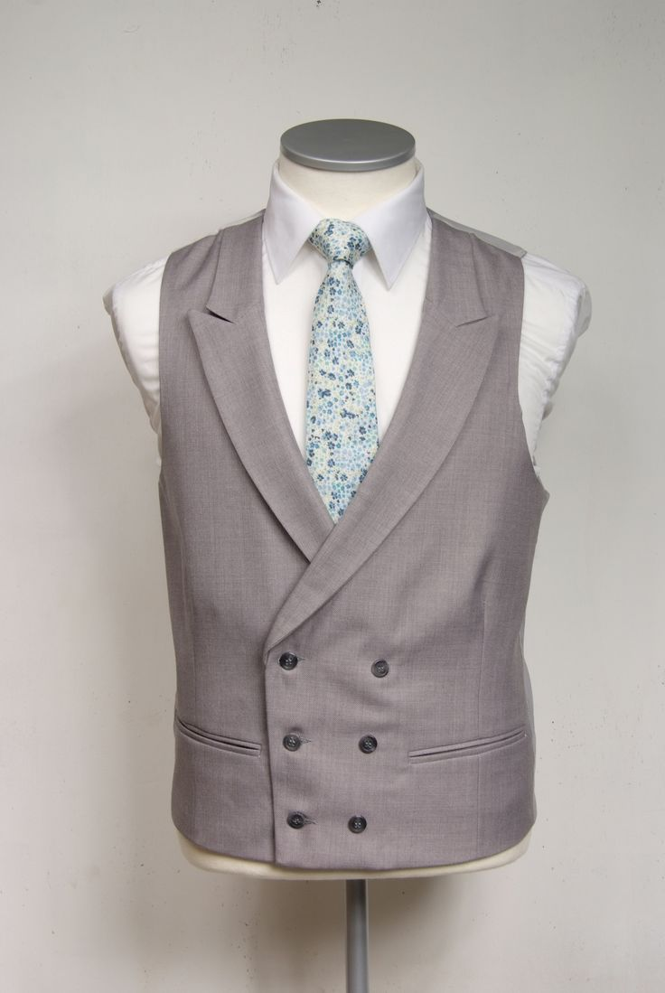 Blue liberty floral print tie £39.50 with grey double breasted waistcoat £90.00 #groom #wedding #libertyprint