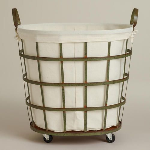 One of my favorite discoveries at WorldMarket.com: Skyler Metal Rolling Hamper for under the laundry shoot