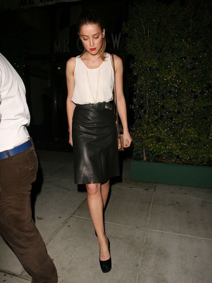 Amber Heard wearing our LEATHER EQUESTRIAN SKIRT. http://www.monikachiang.com/leather-equestrian-skirt.html