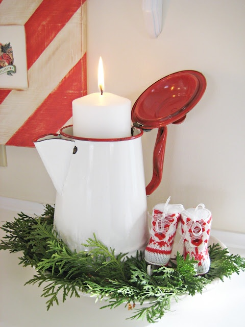 Red and White Christmas Kitchen.  The Primitive Pinecone staff loves the simplicity of the candle in this pot which is surrounded by greens.  www.hillfarms.com