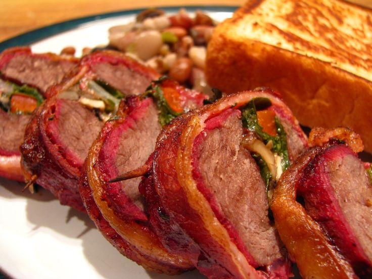 Wood fired stuffed venison backstrap, how to smoke venison backstrap, how to cook deer on the grill, bacon wrapped venison recipe, how to co...