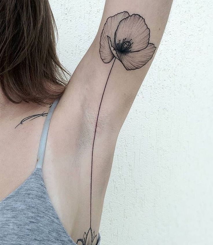 Poppy tattoo by Michele Volpi.   Poppy tattoos are extraordinary and we have found some of the most exquisite poppy tattoos ever done. Thanks for caring, thanks for sharing.