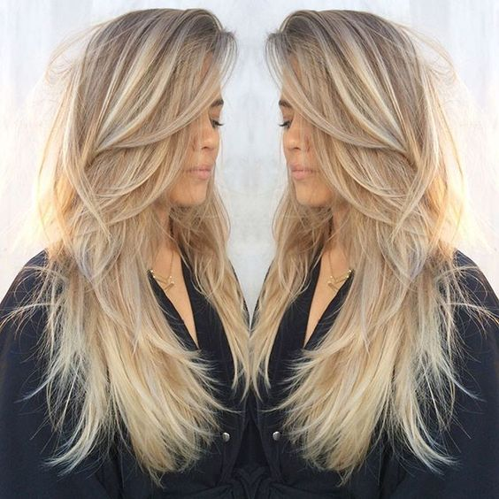 Long Straight Hair With Dynamic Ash Blonde Coloring And Tons Of
