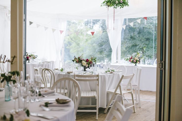 All white vintage chairs for a wedding breakfast at @thegreencornwal