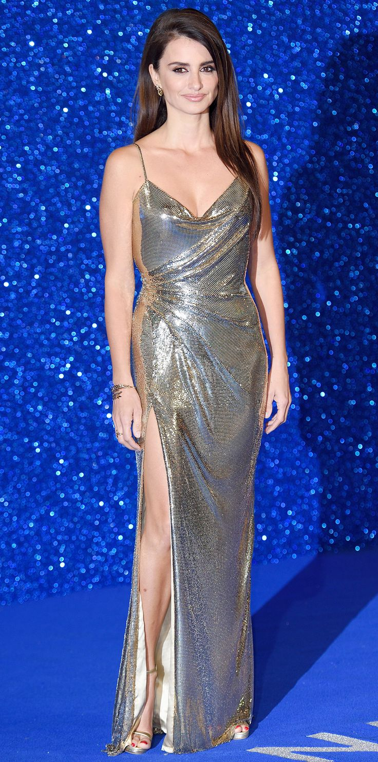 Penelope Cruz upped the glam for the Zoolander 2 premiere—she was outfitted in a custom gold chainmail Atelier Versace gown that she styled with matching Versace clutch and sandals, and Chopard diamonds.