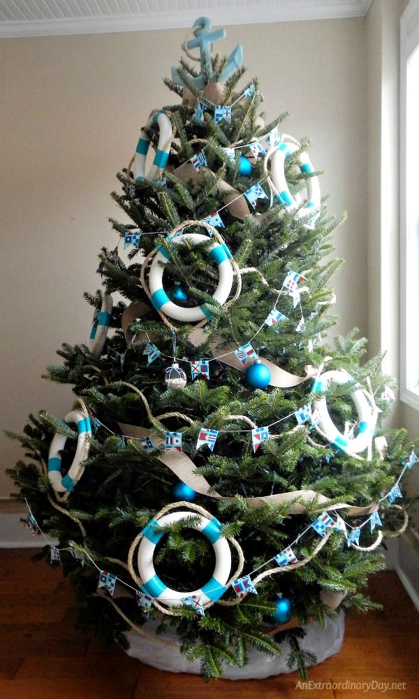 Unique Ways to Decorate a Nautical Christmas Tree with Pennant Banner Garland and Life Rings