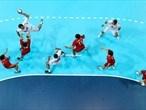 Serbia shoot at goal during the men's Handball preliminaries