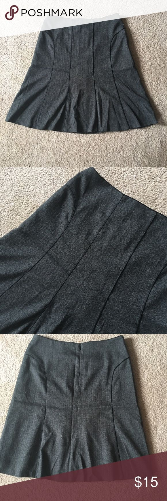 Curvy friendly charcoal gray skirt This is one of my fave skirts, I'm selling it because it's too small. It hugs your curves and then bellows out at the bottom. It has piping detail on the front and back to help emphasize or create curves. Skirt has a built in liner.  Not stretchy, in great condition, smoke free home Sorry no holds, trades or free shipping Judith Hart Skirts A-Line or Full