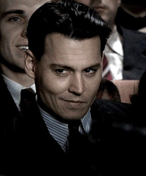 "Johnny Depp as John Dillinger in the 2009 film, ""Public Enemies."""