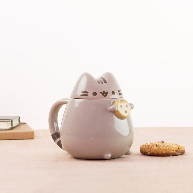 Keep your drinks at the puuurfect temperature with the Pusheen Mug. Dip a cookie and sip from the gaping neck of the internet's favourite feline. Just be sure