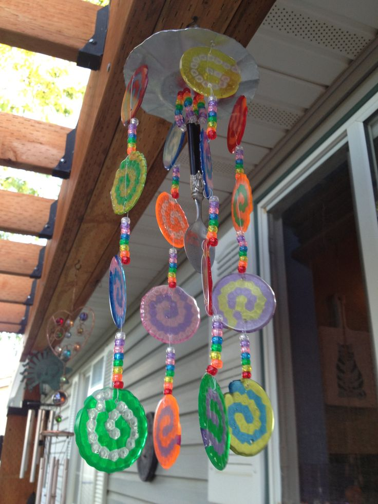 windchime from melted pony beads...so I wonder if I could make some ornaments this way? Looks like it would work just fine.