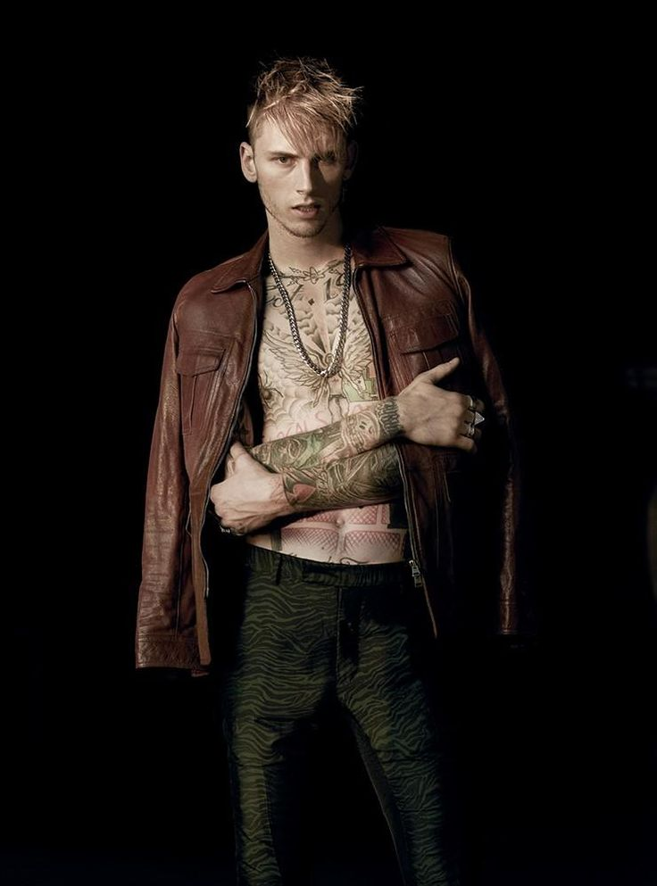Machine Gun Kelly rocks a brown leather jacket from Tom Ford with patterned Lanvin trousers for L'Uomo Vogue.
