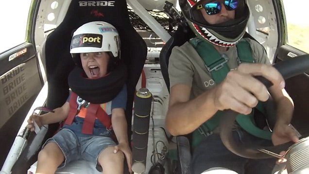 Kazakh boy's priceless reaction as his father takes him drift racing | Daily Mail Online