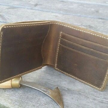 Our new product. Vegetable tanned distressed leather bifold wallet.