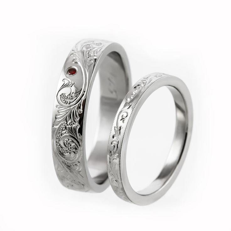 Hand engraved rings with a small ruby.