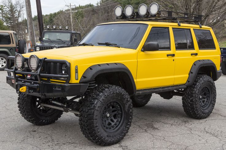 """Engine: 4.0L Inline-6 Exterior: Yellow Line-X Lift Height: 6.5"""" Tire Size: 35 Inches"""