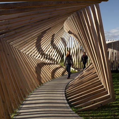 Visitors to this installation in northern Denmark by German artist Thilo Frank are invited to walk through a contorted loop of timber while listening to the sounds of their voices and footsteps played back to them (+ slideshow).