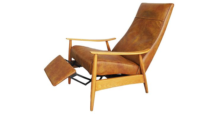 Whiskey-brown leather recliner chair with solid oak frame designed by Milo Baughman for Thayer Coggin. The chair opens with a slight seated push. Label on underside of foot rest. Reclining...