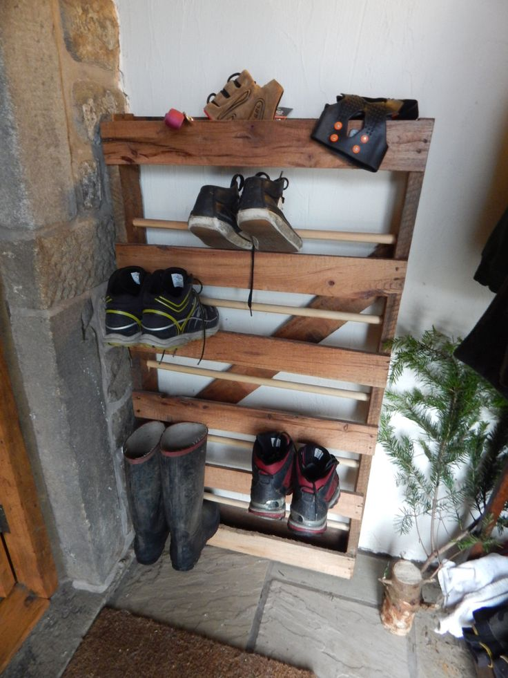 Rustic Shoe Rack Storage Made from Reclaimed Asian Hard Wood Pallet, by GeorgeScottdesign on Etsy https://www.etsy.com/listing/221709188/rustic-shoe-rack-storage-made-from