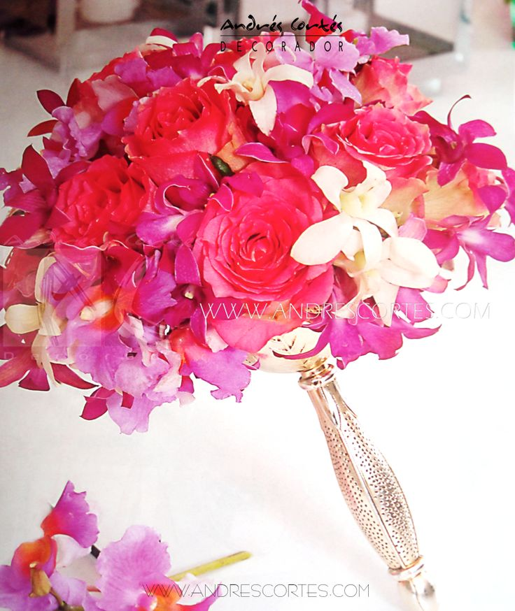 The merger of orchids and roses in purple, pink and white make this bouquet perfect for spring. Design by Andrés Cortés. #andrescortes #Bouquet #WeddingIdeas