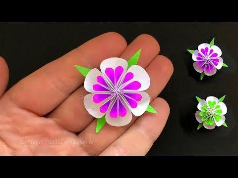 Wie man aus Papier kleine Blumen basteln kann. Wei…