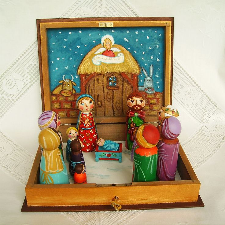 Christmas nativity set book box case Holy Family Three Kings painted wooden scene creche crib angel baby Jesus Christ Joseph Mother Mary peg doll figurine traditional colorful folk art child birthday birth christening baptism holiday communion gift present red souvenir keepsake heart snow manger figure holy night Blessed Virgin God decoration stable decor religious shed blue Madonna star Three Magi Wise Men crosier winter wooden peg dolls cradle stable shepherd mule donkey cow animals