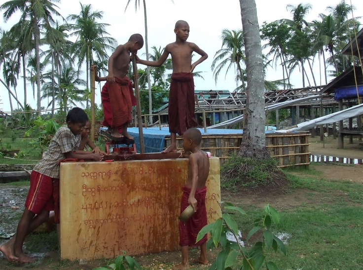 """""""Children trying to get water with a handpump near the communal water tank built inside a monastery compound. Thar Yar Gone village, Pyinkayaing Township   © Mon Mon Myat/IRIN"""""""