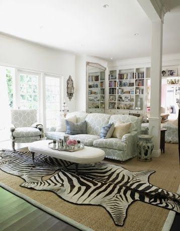 Double Zebra Rugs Layered Over Sisal Area Rug For Larger Areas.