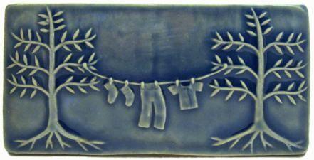 clothesline art tile with blue glaze