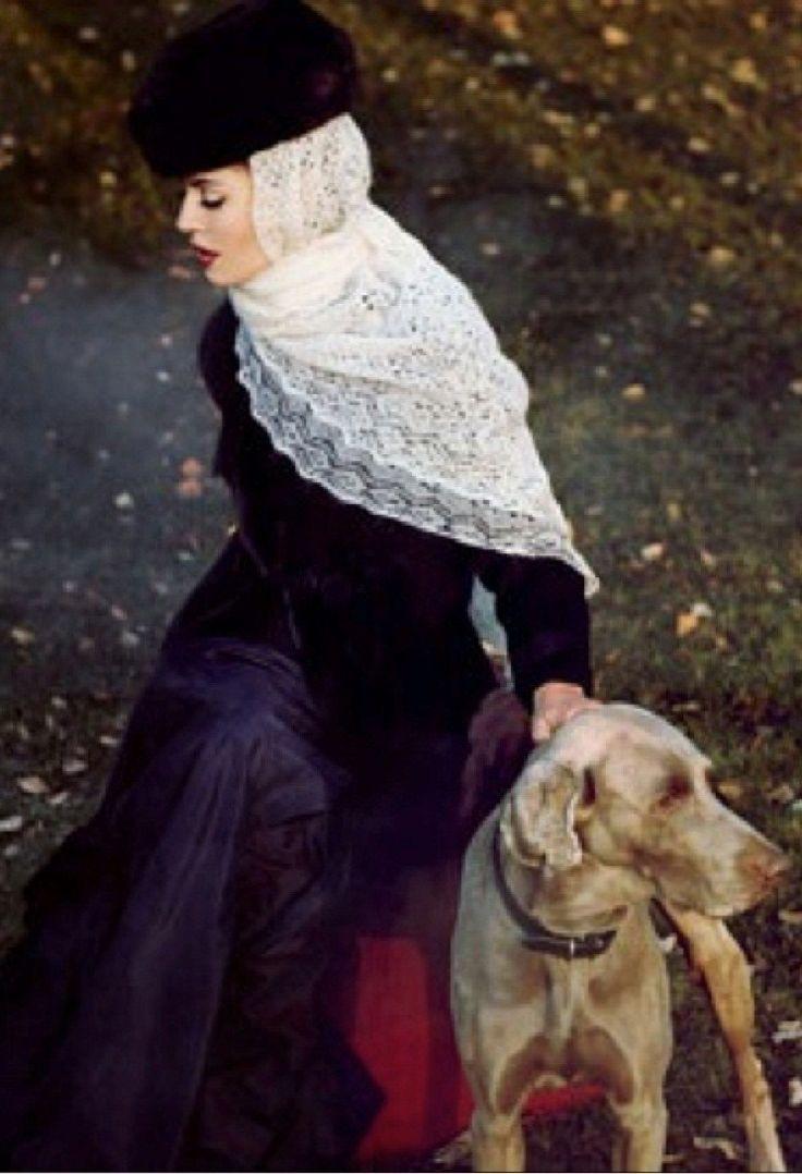 A pretty girl in an Orenburg shawl and a dog. #folk #Russian #shawl